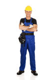 Full length mature worker with folded arms Stock Photo
