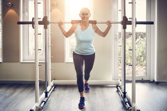 Full-length of middle-aged woman in sportswear stock photo