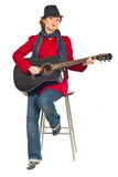 Full length of modern woman with guitar Royalty Free Stock Photos