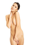 Full length of nude woman covering her intimate places Stock Photography