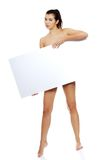 Full length nude woman holding blank banner Stock Images