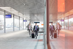 Free Full Length Of Businessmen With Luggage Rushing On Railroad Platform Royalty Free Stock Image - 85302596