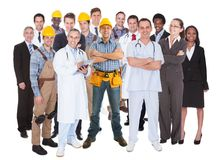 Full length of people with different occupations. Standing against white background Stock Photos