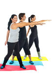 Full length of people doing fitness Royalty Free Stock Photos