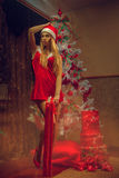 Full length photo of beautiful blonde woman dressed as Santa wit Stock Images