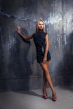 Full length photo of blonde woman in short dress looking away an Royalty Free Stock Photos
