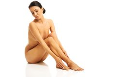 Full length photo of nude woman sitting Stock Photo