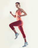 Full-length photo of running woman over white background Royalty Free Stock Image