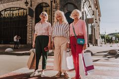 Nice grandmothers are standing on street together stock images