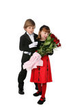 Full length picture of children with flowers. Children in formal clothes and a bouquet of red roses Royalty Free Stock Photo