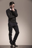 Full length picture of a handsome business man thinking. Royalty Free Stock Photography