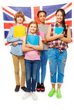 Full-length picture of kids against British flag Royalty Free Stock Photography