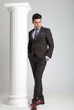Full length picture of a young business man looking down Royalty Free Stock Photos