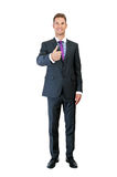Full length picture of a young business man showing thumb up and Stock Image