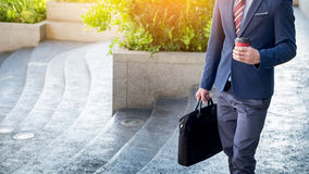 Full length picture of a young business man walking forward with Stock Images