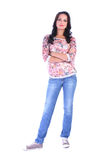 Full length picture of young woman in jeans standing Stock Photo