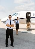 Full Length Pilot Against Stewardess And Private Stock Images