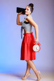 Full length pin-up girl woman with clock going on a date. Stock Photo