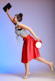 Full length pin-up girl woman with clock is late for date. Royalty Free Stock Images