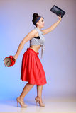 Full length pin-up girl sexy woman with clock is late for date. Stock Photo
