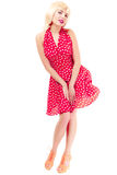 Full length pinup girl in blond wig retro dress Royalty Free Stock Photo