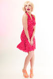 Full length pinup girl blond wig retro red dress Stock Photography