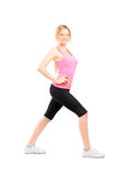 Full length portrait of an active young woman exercising Stock Photos
