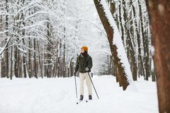 Active Woman Skiing in Forest stock image