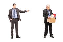 Full length portrait of an angry boss firing an employee Stock Images