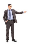 Full length portrait of an angry businessman pointing with his f Royalty Free Stock Photo