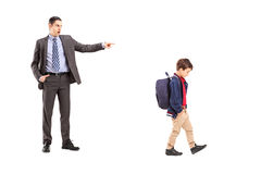 Full length portrait of an angry father shouting at his son. Isolated on white background stock images