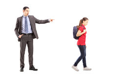 Full length portrait of angry father yelling at his daughter. Isolated on white background stock images