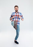 Full length portrait of angry man kicking Stock Photography