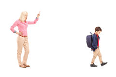 Full length portrait of an angry mother shouting at her son Stock Photography