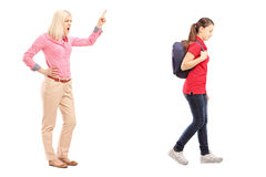 Full length portrait of angry mother yelling at her daughter Royalty Free Stock Photo