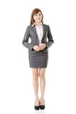 Full length portrait of Asian business woman. Wear skirt suit, isolated on white background stock photos