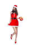 Full length portrait of a asian woman in santa claus cloth holding gift box isolated on a white background royalty free stock photo