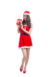 Full length portrait of a asian woman in santa claus cloth holding gift box isolated on a white background stock photography