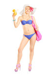 Full length portrait of an attractive blond woman in bikini hold Royalty Free Stock Photos