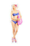 Full length portrait of an attractive blond woman in swimsuit Royalty Free Stock Photo