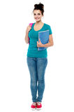 Full length portrait of attractive college girl Royalty Free Stock Images
