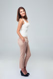 Full length portrait of attractive happy woman Royalty Free Stock Photography