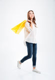 Full length portrait of an attractive woman holding shopping bags Royalty Free Stock Images