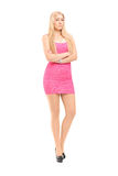 Full length portrait of an attractive woman posing  in a pink dr Royalty Free Stock Image