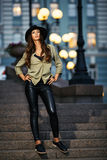 Full length portrait of attractive young woman with black hat. Full length portrait of attractive elegant young woman with black hat standing on the stair royalty free stock photos