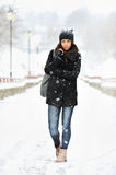 Full length portrait of attractive young woman in winter park Stock Photos