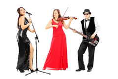 Full length portrait of a band of young musicians Royalty Free Stock Image