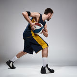 Full length portrait of a basketball player with ball Stock Photos