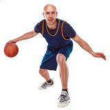 Full length portrait of a basketball player with ball Royalty Free Stock Images