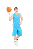 Full length portrait of a basketball player holding a basketball Stock Image